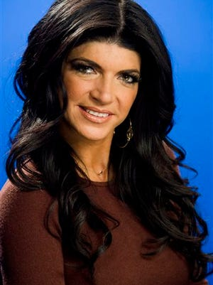 This photo shows Teresa Giudice posing for a portrait in New York. Giudice is scheduled to report to a federal prison in Danbury, Connecticut on Monday, to begin serving a 15-month sentence for bankruptcy fraud. She and husband Joe Giudice pleaded guilty last year. The couple admitted hiding assets from bankruptcy creditors and submitting phony loan applications to get some $5 million in mortgages and construction loans.