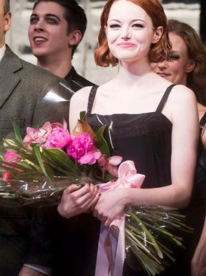 """This file photo shows Emma Stone appearing at the curtain call following her debut performance in Broadway's """"Cabaret"""" in New York. Stone plans to stick around the Kit Kat Klub, she's extending her stay in the current Broadway revival of """"Cabaret."""" Roundabout Theatre Company said Sunday that Stone will now star as Sally Bowles for an additional two weeks through Feb. 15."""