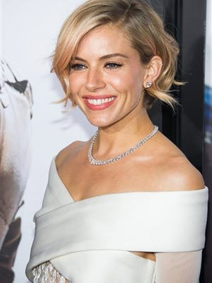 """In this file photo, actress Sienna Miller attends the """"American Sniper"""" premiere in New York. Roundabout Theatre Company said Wednesday that Miller will take over the """"Cabaret"""" role of Sally Bowles from Emma Stone on Feb. 17 and play the final six weeks of the limited engagement through March 29."""