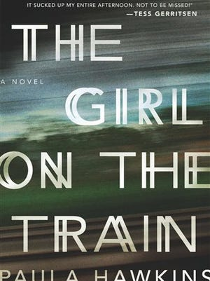 """This photo provided by Riverhead Books shows the cover of the book, """"The Girl on the Train,"""" by author Paula Hawkins. (AP Photo/Riverhead Books)"""