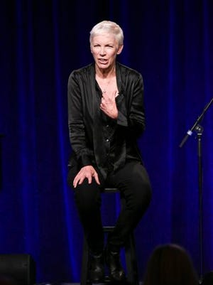 """Annie Lennox speaks on stage during the """"Annie Lennox: Nostalgia Live in Concert"""" performance and press conference at the PBS 2015 Winter TCA on Monday, Jan. 19, 2015, in Pasadena, Calif. (Photo by Richard Shotwell/Invision/AP)"""