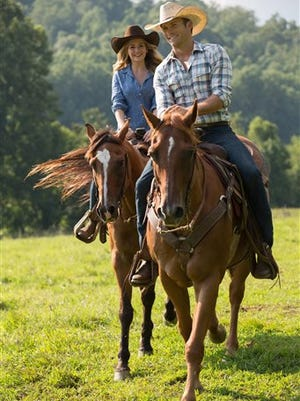 """In this image released by 20th Century Fox, Britt Robertson, left, and Scott Eastwood appear in a scene from """"The Longest Ride."""" (AP Photo/20th Century Fox, Michael Tackett)"""