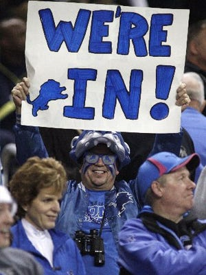 Notice the correct spelling and punctuation in this Lions fan's sign.