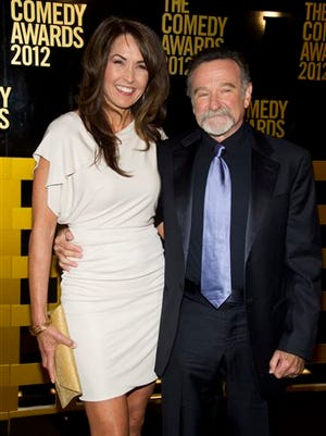 File-This April 28, 2012, file photo shows Robin Williams, left,  and wife Susan Schneider arrive to The 2012 Comedy Awards in New York. The family of Williams  is fighting over how to split the actor's estate after meeting with a mediator. Court records show that the actor's widow, Susan Williams, and his three children remain divided over how much cash the widow should receive. The two sides have settled most of their differences over dividing the actor's personal effects. A hearing has been scheduled for Monday in San Francisco Superior Court. The judge scheduled the hearing two months ago hoping the two sides would reach a complete settlement by Monday. (AP Photo/Charles Sykes, File)