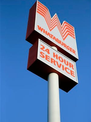 This Thursday, July 9, 2015 photo shows a Whataburger restaurant in San Antonio, Texas. The iconic Texas restaurant chain will not allow the open carrying of guns on its properties, taking a stand against a new law legalizing the practice.