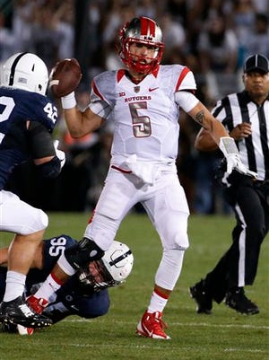 Rutgers quarterback Chris Laviano (5) gets rid of the ball under pressure from Penn State defensive end Carl Nassib (95) and Penn State linebacker Troy Reeder (42) during the first half of an NCAA college football game in State College, Pa., Saturday, Sept. 19, 2015. (AP Photo/Gene J. Puskar)