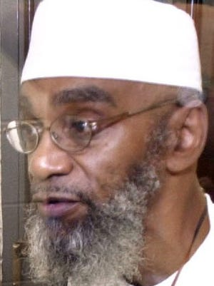 Abu-Ali Abdur'Rahman speaks through the glass window in an interview room at Riverbend Maximum Security Institution in Nashville, Tenn., in this June 4, 2003 file photo. Abdur'Rahman was convicted of murder and sentenced to die in 1987. Abdur'Rahman is challenging Tennessee's method of execution, which includes a drug forbidden in the euthanasia of animals, on Wednesday, June 8, 2005. in front of the state Supreme Court.