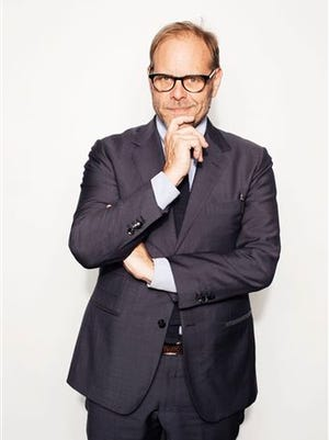 """In this Oct. 26, 2016 photo, Alton Brown poses for a portrait in New York to promote his cookbook, """"EveryDayCook: This Time It's Personal,"""" and  a live Broadway variety show with a mix of unusual food demonstrations, puppets and songs."""