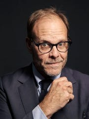 "In this Oct. 26, 2016 photo, Alton Brown poses for a portrait in New York to promote his cookbook, ""EveryDayCook: This Time It's Personal,"" and  a live Broadway variety show with a mix of unusual food demonstrations, puppets and songs."