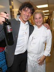 """This Oct. 20, 2016 photo provided by the Slovenia Tourist Board shows Valter Kramar and his wife, chef Ana Ros, at an event in  showcasing her culinary repertoire in New York. Ros heads the kitchen in a remote village inn in Slovenia called Hisa Franko that Kramar inherited from his father. Ros starred in an episode of the Netlix """"Chef's Table"""" series. The New York City event also touted other attractions in Slovenia, where tourism has been growing."""