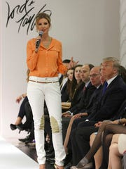 FILE - In this Wednesday, March 28 2012, file photo, Ivanka Trump wears an outfit she designed as she speaks to the audience prior to the presentation of her Ready-To-Wear Collection at the Lord & Taylor flagship store in New York. Trump's father, Donald, is seated to the right. Retailers are trying to figure out a way to deal with the politically charged Ivanka Trump brand, stamped on everything from shoes to pants to handbags. The products have become more polarized with President Donald Trump's rise to The White House, and retailers are trying to be careful not to offend shoppers from both sides of the political aisle.
