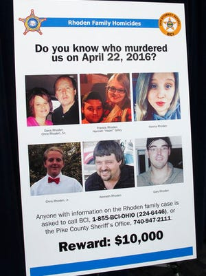 A poster asking for information about the unsolved killings of eight family members in southern Ohio on April 22, 2016, is displayed at the Ohio Attorney General's Office during a press conference on Thursday, April 13, 2017, in Columbus Ohio.