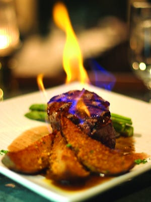 Seven Seas' flaming steak is among the many favorites at the Lake Country restaurant.