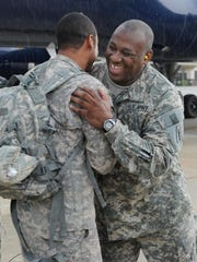 Staff Sgt. Paul Martin embraces a fellow soldier after