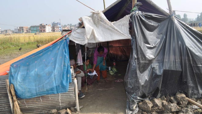 Nepali villagers who cannot afford to rebuild live in tents.
