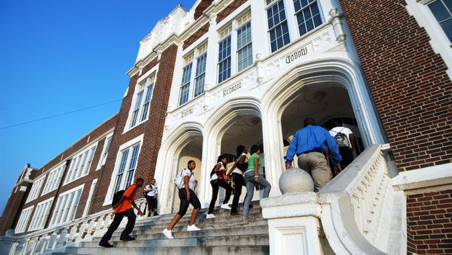 High school students make their way up the stairs on the first day of school at Academy of Richmond County, Monday, Aug. 9, 2010, in Augusta, Ga.