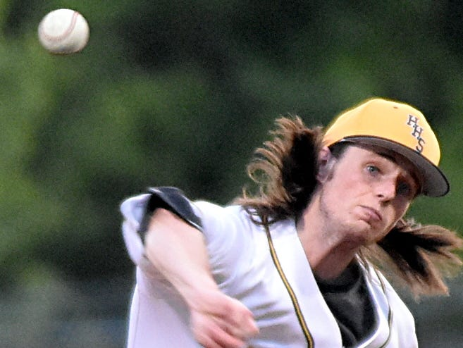 Hendersonville High senior Will Wacaser delivers a first-inning pitch.