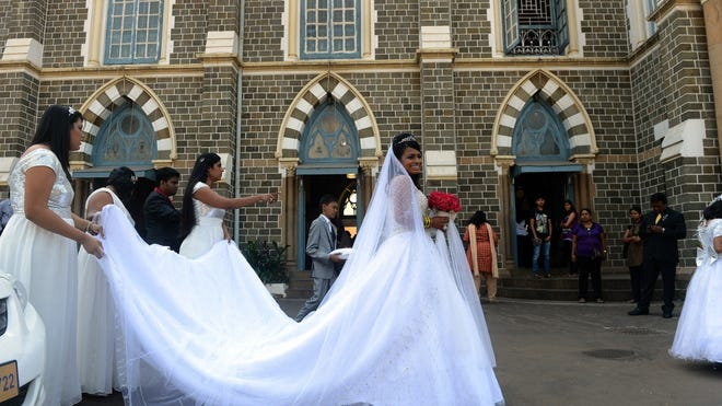 Bride Emilia D'Silva smiles as she arrives at the Mount Mary church in Mumbai on Dec. 12, 2012.