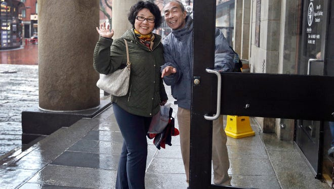 In this March 27, 2017 photo, tourists from China enter Quincy Market in Boston. In cities across the country, the American hospitality industry is stepping up efforts to make Chinese visitors feel more welcome.