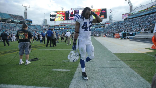 Rookie Clayton Geathers walks off the field after the Colts' lopsided loss at Jacksonville, Dec. 13, 2015.
