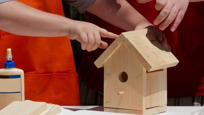 Kids building a birdhouse.