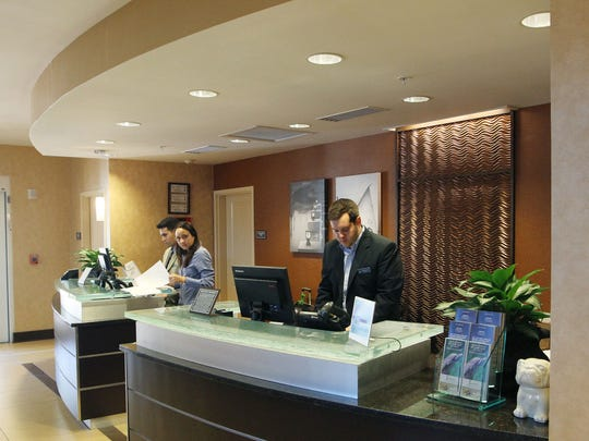Adam Winning, 23, works the front desk as the assistant general manager at the Residence Inn, Gulf Coast Town Center.