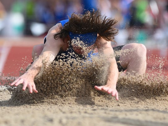 Reading's Justin Dreyling competes in the long jump