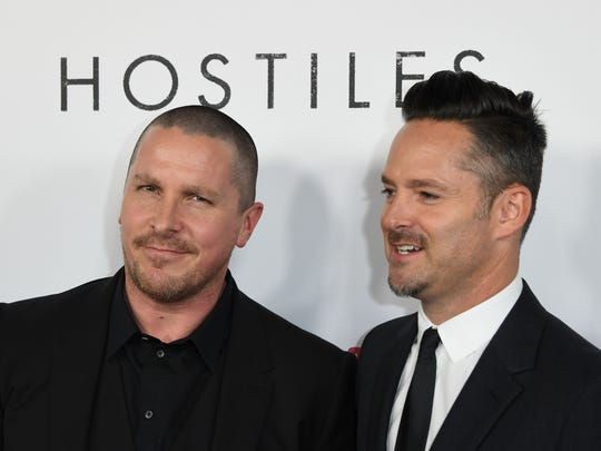 """Christian Bale (left) and writer-director Scott Cooper attend the premiere of """"Hostiles"""" on Dec. 14, 2017, in Beverly Hills, California."""