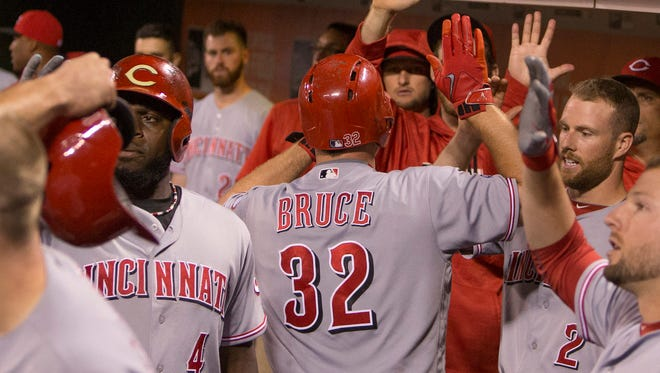 Cincinnati Reds right fielder Jay Bruce (32) celebrates with teammates after hitting a two-run home run during the sixth inning against the San Francisco Giants at AT&T Park.