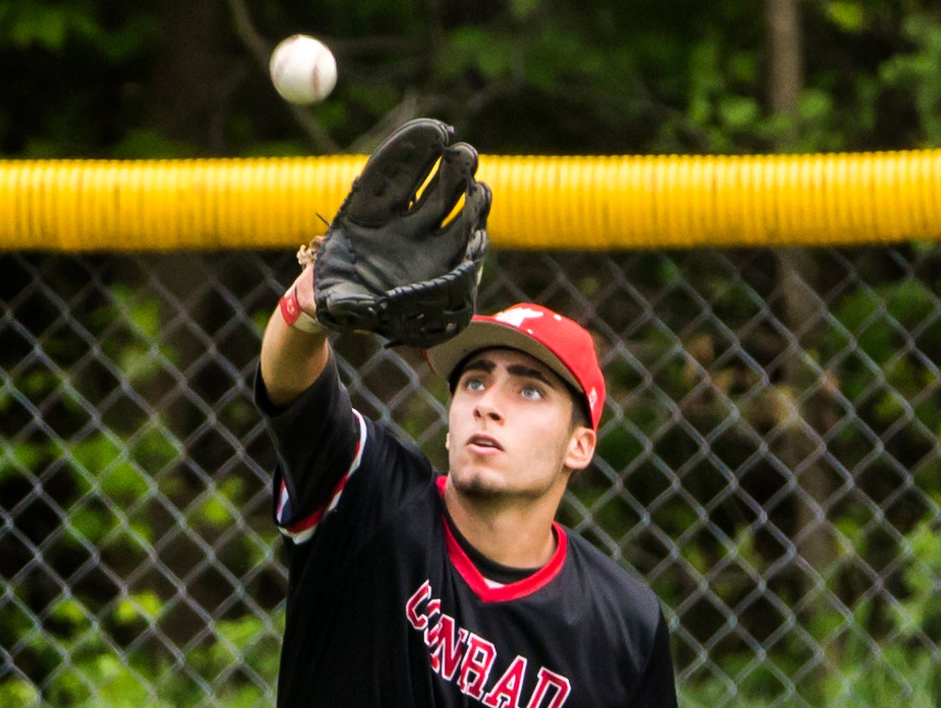 Conrad's Dominic Wayne fields a ball in the outfield in Conrad's 1-0 win over Delaware Military Academy in Newark on Tuesday afternoon.