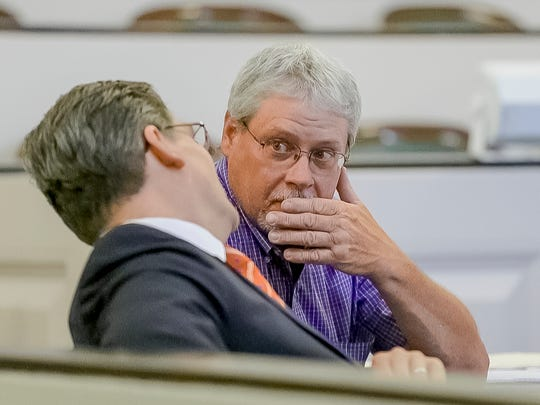 Defense attorney Kenneth Moynihan, left, talks with defendant Jeffrey Horton before opening arguments June 2, 2016, at Horton's trial in Tompkins County Court.