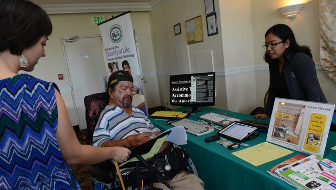 In this file photo, Thomas Manglona of Barrigada, center, fills out a survey conducted by the University of Guam Center for Excellence on Developmental Disabilities Education, Research and Service.