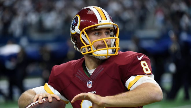 Washington Redskins quarterback Kirk Cousins (8) throws a pass as he warms up before a Week 17 game against the Dallas Cowboys.