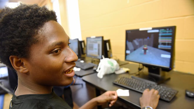 Nicholas Henderson, 17, plays games on a computer at the Edgehill branch library. Edgehill Apartments will be the first to gain access to Google Fiber's free gigabit speed Internet.