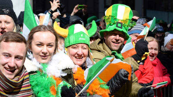Fans watch the St. Patrick's Day Parade on New York's 5th Ave.