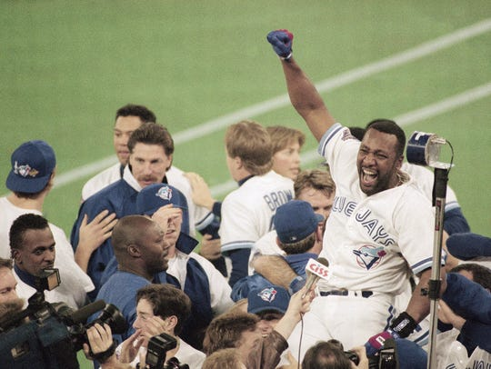 Blue Jays right fielder Joe Carter hit a walk-off home run in Game 6 of the 1993 World Series to claim the title over the Phillies.