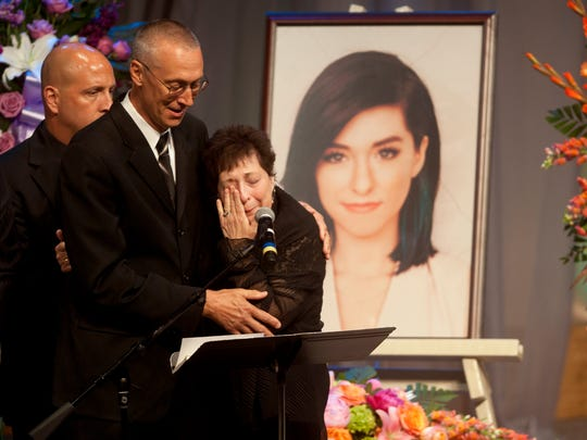 Christina Grimmie's mother Tina is comforted by her husband Bud as Tina speaks during a memorial service held for their daughter at Fellowship Alliance Chapel  in Medford, NJ, on Friday, June 17, 2016.