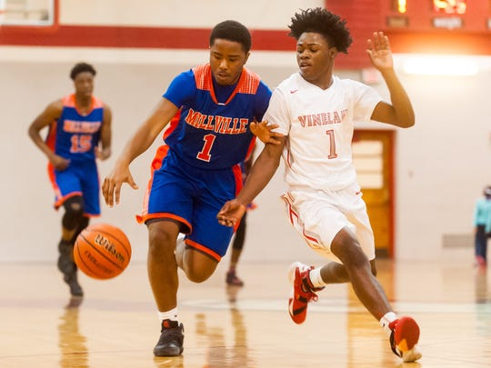 Millville guard Lonnie Broome (1) works up court while