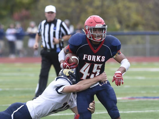 Chenango Forks' Jeremiah Allen looks to shake a tackle during a  Section 4 Football Conference game against Susquehanna Valley.