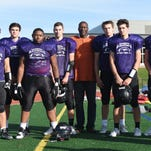 Coach Lomas Brown (center) is proud of his Bloomfield Hills offensive line which includes current starters (left to right) Howard Shoda, Jack Sape, Malcolm Clark, Ethan Mackie, Grant Ellis, Alex Emde and Matt Borck.