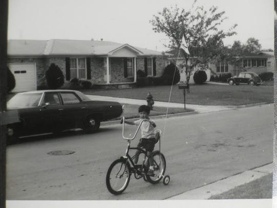 A young Richard Tom rides a bike in this undated photo.