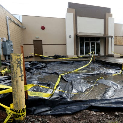 Soil is being replaced outside a commercial building