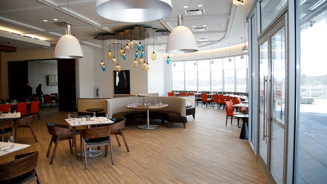 One of the main dining rooms at the new Summit Hotel in the Madisonville neighborhood of Cincinnati on Wednesday, April 18, 2018.