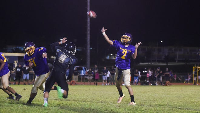 The Tiyan Titans took on the George Washington Geckos for their Interscholastic Football League game at George Washington High School field in Mangilao on Sept. 10.
