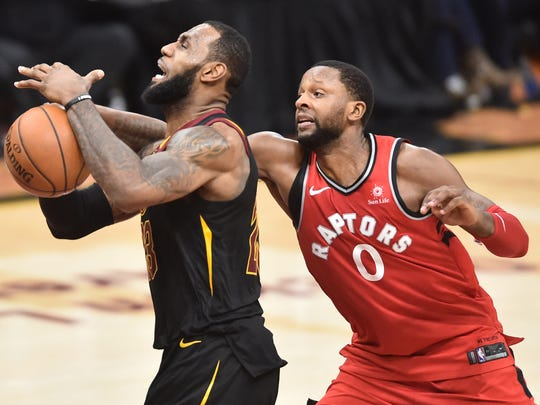 May 5, 2018; Cleveland, OH, USA; Toronto Raptors forward CJ Miles (0) fouls Cleveland Cavaliers forward LeBron James (23) during the second half in game three of the second round of the 2018 NBA Playoffs at Quicken Loans Arena. Mandatory Credit: Ken Blaze-USA TODAY Sports