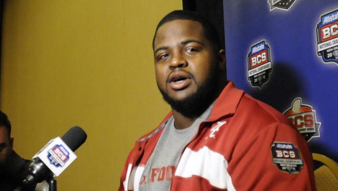 Josh Chapman, shown before his final game as an Alabama player in January 2012, was hired as an assistant strength coach last year.