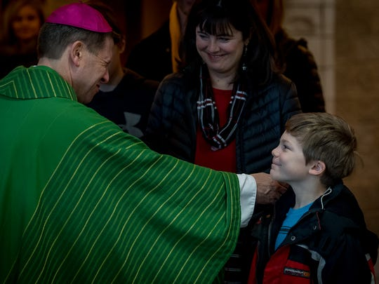 Bishop J. Mark Spalding greets parishioners after celebrating