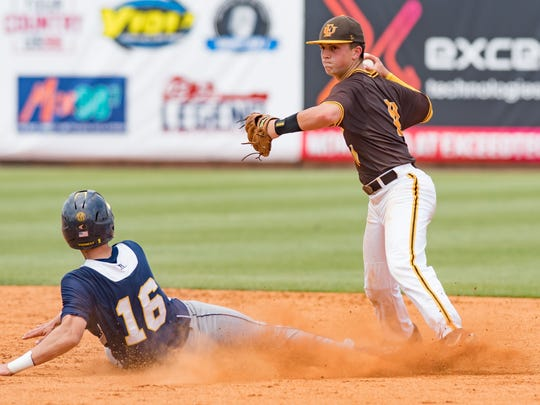 East Union shortstop Ethan Hitt (11) looks to turn a double play as St. Joseph's (16) slides in during the MHSAA 2A Baseball Championships held at Trustmark Park Wednesday May 15, 2018.(Bob Smith-For The Clarion Ledger)