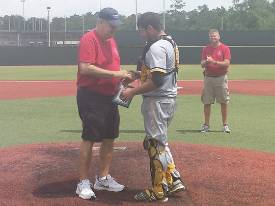 Fairview's Garrett Lavergne accepts the Class B MVP award from an LHSAA official.