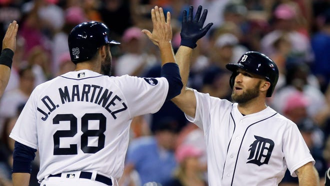 Tigers centerfielder Tyler Collins celebrates his three-run home run with J.D. Martinez during the fifth inning of the Tigers' 5-4 win Wednesday at Comerica Park.